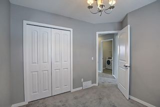 Photo 38: 566 River Heights Crescent: Cochrane Semi Detached for sale : MLS®# A1129968