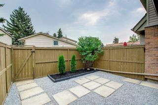 Photo 33: 77 123 Queensland Drive SE in Calgary: Queensland Row/Townhouse for sale : MLS®# A1145434