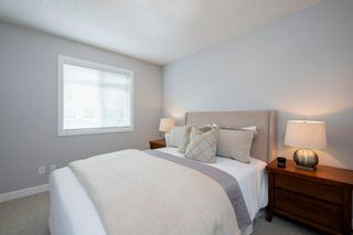 Photo 27: 32 Prominence Park SW in Calgary: Patterson Row/Townhouse for sale : MLS®# A1112438