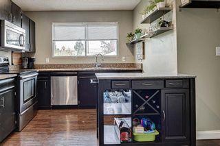 Photo 8: 128 Cedarpark Green SW in Calgary: Cedarbrae Detached for sale : MLS®# A1109711