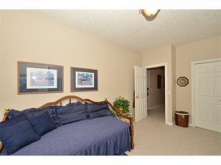 Photo 38: 134 GLENEAGLES View: Cochrane House for sale : MLS®# C4018773