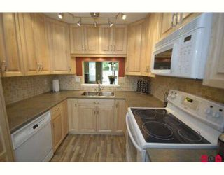 """Photo 2: 61 9386 128TH Street in Surrey: Queen Mary Park Surrey Townhouse for sale in """"Surrey Meadows"""" : MLS®# F2819462"""