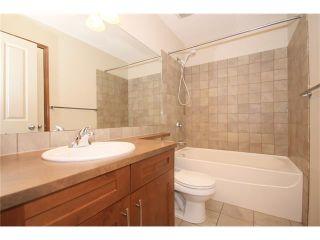 Photo 21: 103 WEST POINTE Court: Cochrane House for sale : MLS®# C4042878