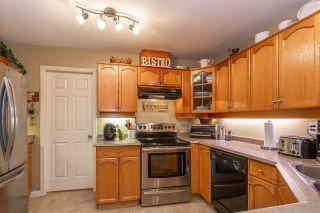 "Photo 2: 104 12464 191B Street in Pitt Meadows: Mid Meadows Condo for sale in ""LASEUR MANOR"" : MLS®# R2324883"