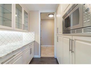 Photo 6: 22 ROCK LAKE View NW in Calgary: Rocky Ridge House for sale : MLS®# C4090662