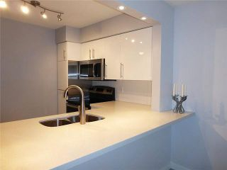 """Photo 3: 206 1330 GRAVELEY Street in Vancouver: Grandview VE Condo for sale in """"HAMPTON COURT - COMMERCIAL DRIVE"""" (Vancouver East)  : MLS®# V1075644"""