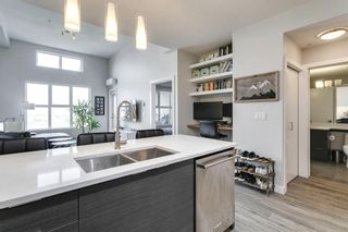 Photo 6: 1406 95 Burma Star Road SW in Calgary: Currie Barracks Apartment for sale : MLS®# A1134352