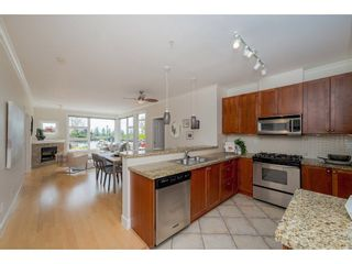 """Photo 4: 102 4500 WESTWATER Drive in Richmond: Steveston South Condo for sale in """"COPPER SKY WEST"""" : MLS®# R2266032"""