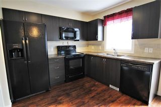 Photo 5: 157 Copperpond Heights SE in Calgary: Copperfield Row/Townhouse for sale : MLS®# A1090874