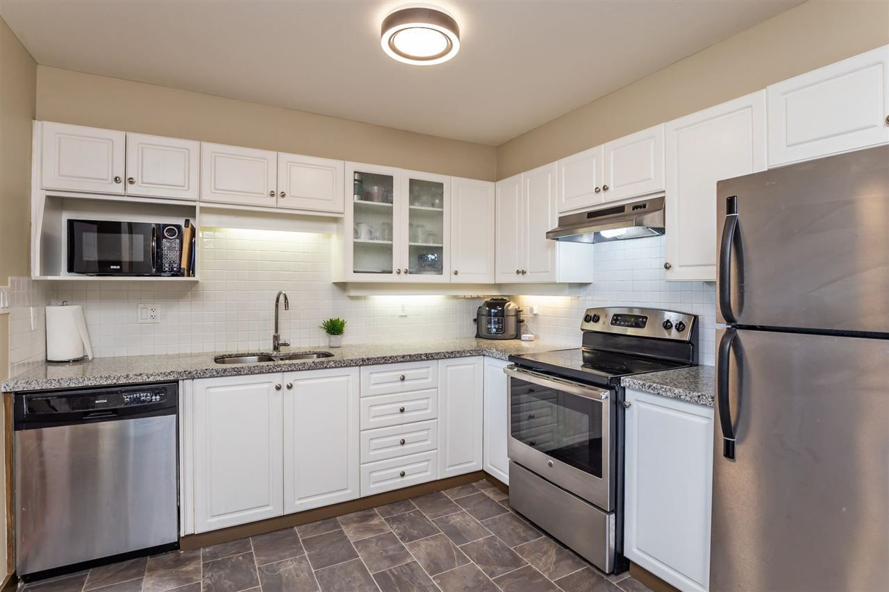 """Main Photo: 410 33731 MARSHALL Road in Abbotsford: Central Abbotsford Condo for sale in """"Stephanie Place"""" : MLS®# R2590546"""