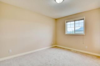 Photo 30: 66 Crystal Shores Cove: Okotoks Row/Townhouse for sale : MLS®# C4305435