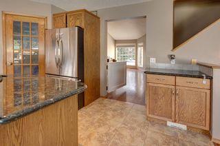 Photo 7: 91 Douglas Woods Hill SE in Calgary: Douglasdale/Glen Detached for sale : MLS®# A1017317