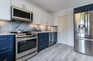 """Photo 5: 301 15255 18 Avenue in Surrey: King George Corridor Condo for sale in """"The Courtyard"""" (South Surrey White Rock)  : MLS®# R2599838"""