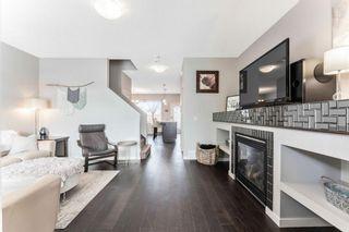 Photo 2: 76 Fireside Way: Cochrane Semi Detached for sale : MLS®# A1076919