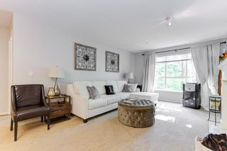 Photo 4: 310 13860 70 Avenue in Surrey: East Newton Condo for sale : MLS®# R2593741