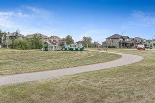 Photo 35: 494 Boulder Creek Way SE: Langdon Semi Detached for sale : MLS®# A1148702