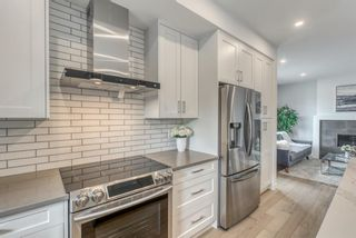 Photo 17: 98 23 Street NW in Calgary: West Hillhurst Row/Townhouse for sale : MLS®# A1066637