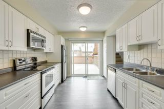 """Photo 3: 205 CAMBRIDGE Way in Port Moody: College Park PM Townhouse for sale in """"EASTHILL"""" : MLS®# R2371317"""