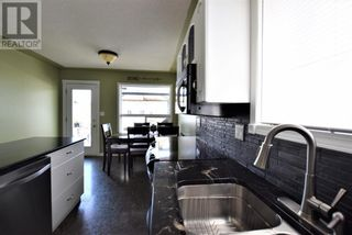 Photo 4: 224 14 Street E in Brooks: House for sale : MLS®# A1128343