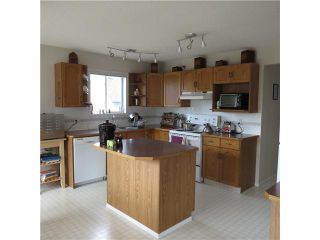 Photo 3: 6 MEADOW Way: Cochrane Residential Detached Single Family for sale : MLS®# C3611505