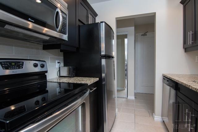 Photo 7: Photos: 306 1710 Taylor Avenue in Winnipeg: River Heights Condominium for sale (1D)  : MLS®# 1820539