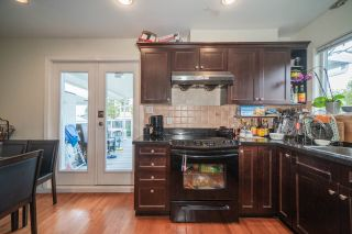 Photo 9: 6255 DOMAN Street in Vancouver: Killarney VE House for sale (Vancouver East)  : MLS®# R2502478