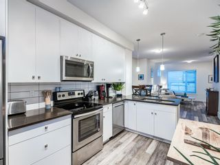 Photo 9: 402 11 Evanscrest Mews NW in Calgary: Evanston Row/Townhouse for sale : MLS®# A1070182