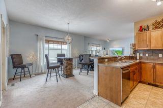 Photo 10: 1401 281 COUGAR RIDGE Drive SW in Calgary: Cougar Ridge Row/Townhouse for sale : MLS®# A1070231