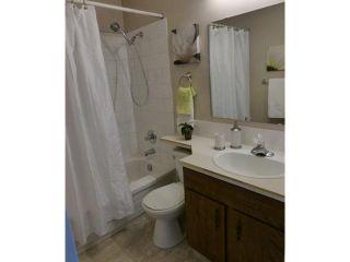 Photo 8: 1212 200 BROOKPARK Drive SW in Calgary: Braeside_Braesde Est Townhouse for sale : MLS®# C3643663