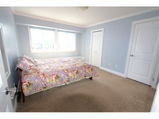 Photo 14: 8075 135A Street in Surrey: Queen Mary Park Surrey House for sale : MLS®# F1444482
