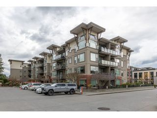 "Photo 1: 410 33538 MARSHALL Road in Abbotsford: Central Abbotsford Condo for sale in ""The Crossing"" : MLS®# R2554748"