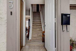 Photo 2: 203 DEERPOINT Lane SE in Calgary: Deer Ridge Row/Townhouse for sale : MLS®# C4288291