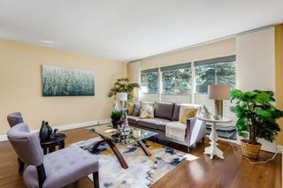 Photo 5: 8023 10 Street SW in Calgary: Chinook Park Detached for sale : MLS®# A1009361