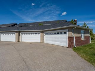 Photo 31: 490 Rainbow Falls Drive: Chestermere Row/Townhouse for sale : MLS®# A1115076