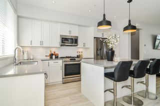 """Photo 7: 44 8371 202B Street in Langley: Willoughby Heights Townhouse for sale in """"Kensington Lofts"""" : MLS®# R2606298"""