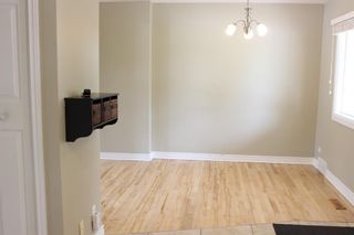 Photo 7: 4312 Amiens Road SW in Calgary: Garrison Woods Semi Detached for sale : MLS®# A1144342