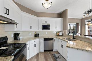 Photo 7: 82 Prestwick Gardens SE in Calgary: McKenzie Towne Row/Townhouse for sale : MLS®# A1079560