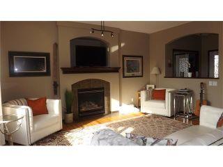 Photo 5: 155 SUNSET Close: Cochrane House for sale : MLS®# C4037159