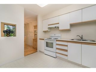 """Photo 3: 104 5565 INMAN Avenue in Burnaby: Central Park BS Condo for sale in """"AMBLE GREEN"""" (Burnaby South)  : MLS®# R2602480"""