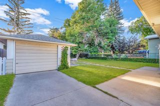 Photo 3: 7827 7 Street SW in Calgary: Kingsland Detached for sale : MLS®# A1030165