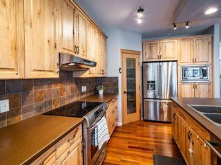 Photo 5: 878 Auburn Bay Boulevard SE in Calgary: Auburn Bay Detached for sale : MLS®# A1077618