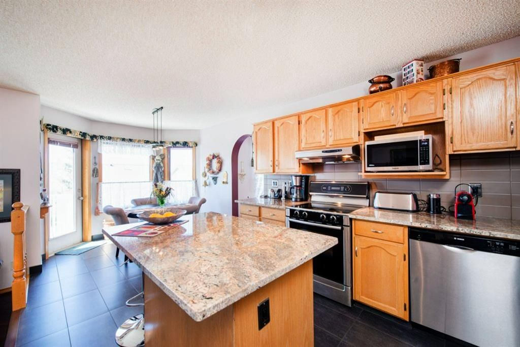 Photo 11: Photos: 142 Arbour Summit Close NW in Calgary: Arbour Lake Detached for sale : MLS®# A1102229