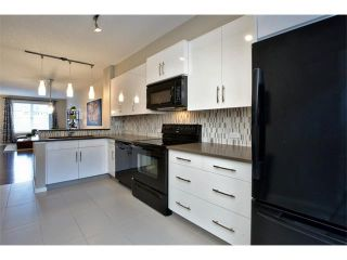 Photo 3: 312 ASCOT Circle SW in Calgary: Aspen Woods House for sale : MLS®# C4003191