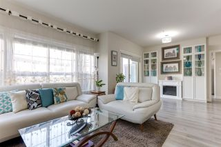 """Photo 1: 106 20219 54A Avenue in Langley: Langley City Condo for sale in """"SUEDE"""" : MLS®# R2561095"""