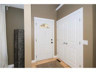 Photo 2: 5 WEST TERRACE Crescent: Cochrane House for sale : MLS®# C4048617