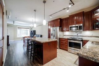 """Photo 2: A408 8218 207A Street in Langley: Willoughby Heights Condo for sale in """"Walnut  Ridge"""" : MLS®# R2588571"""