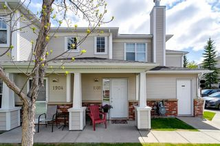 Photo 2: 1905 7171 COACH HILL Road SW in Calgary: Coach Hill Row/Townhouse for sale : MLS®# A1111553