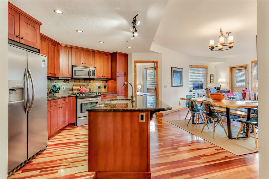 Main Photo: 102 600 Spring Creek Drive: Canmore Apartment for sale : MLS®# A1060926