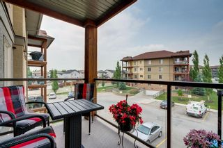 Photo 2: 1302 92 Crystal Shores Road: Okotoks Apartment for sale : MLS®# A1132113