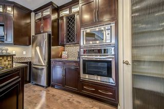Photo 17: 126 Aspen Stone Road SW in Calgary: Aspen Woods Detached for sale : MLS®# A1048425